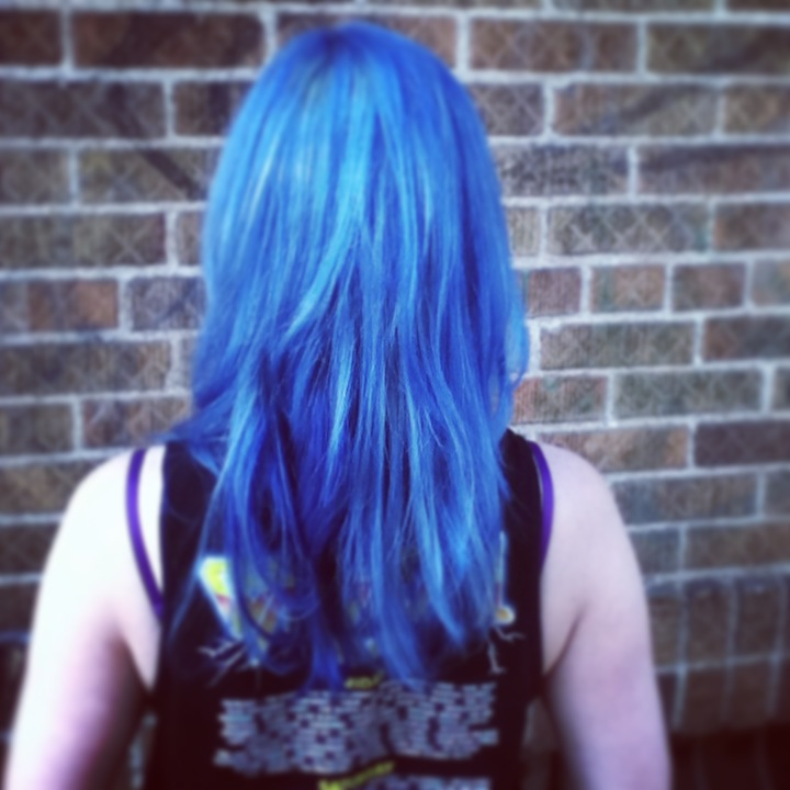 All over double process with 2 different blues to give it the look of denim. Cut and color by Kristin Jackson