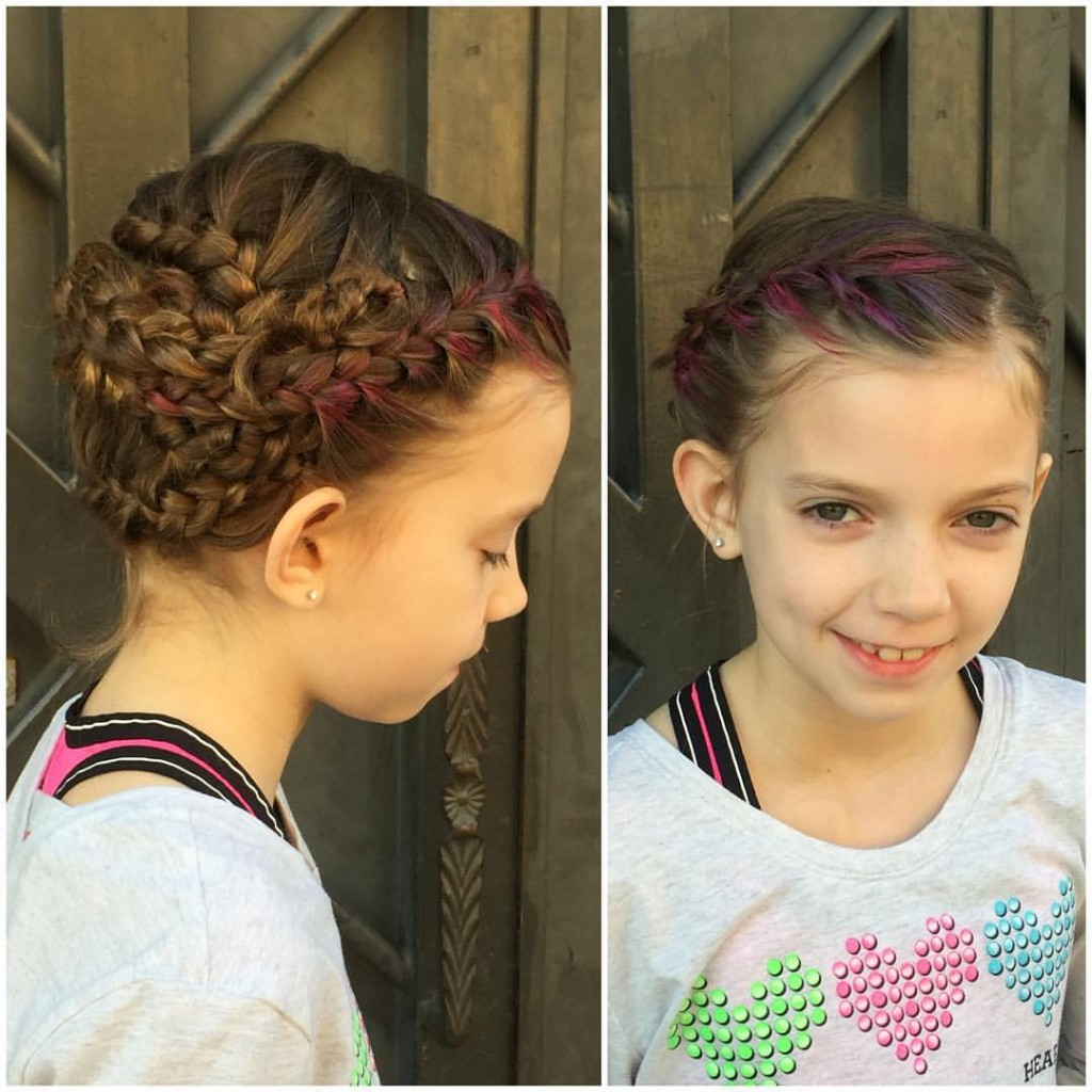 These lovely braids were created by Kristin Jackson. She used Redken's temporary hair makeup Color Rebel. This is a fun way to add a pop of color with no commitment!