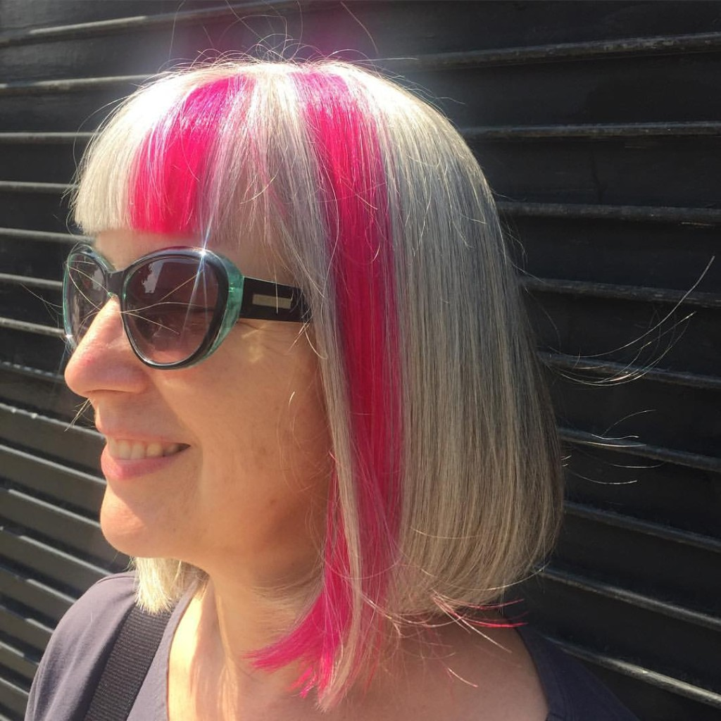Kristin gave our client Pink Panels and killer bangs for her college reunion.