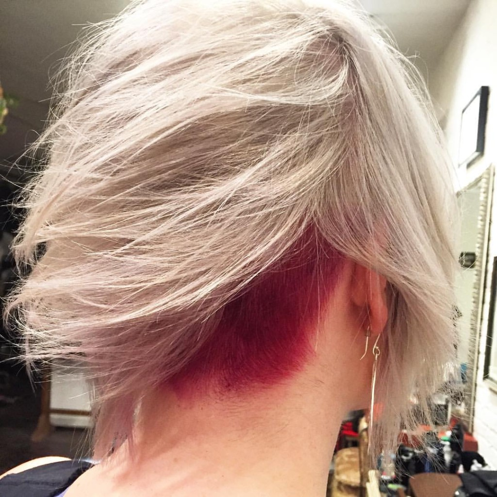 Here's a great example of a hidden or peek-a-boo panel on our double process client. If you can't go full on unicorn why not do on the underneath! Cut and color by Kristin Jackson.