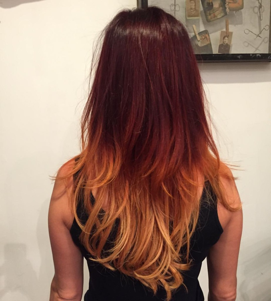 Color Melt Ombre by Kristin Jackson. Kristin applied a permanent color root to mid shaft and lightened the ends to achieve this ombre look.