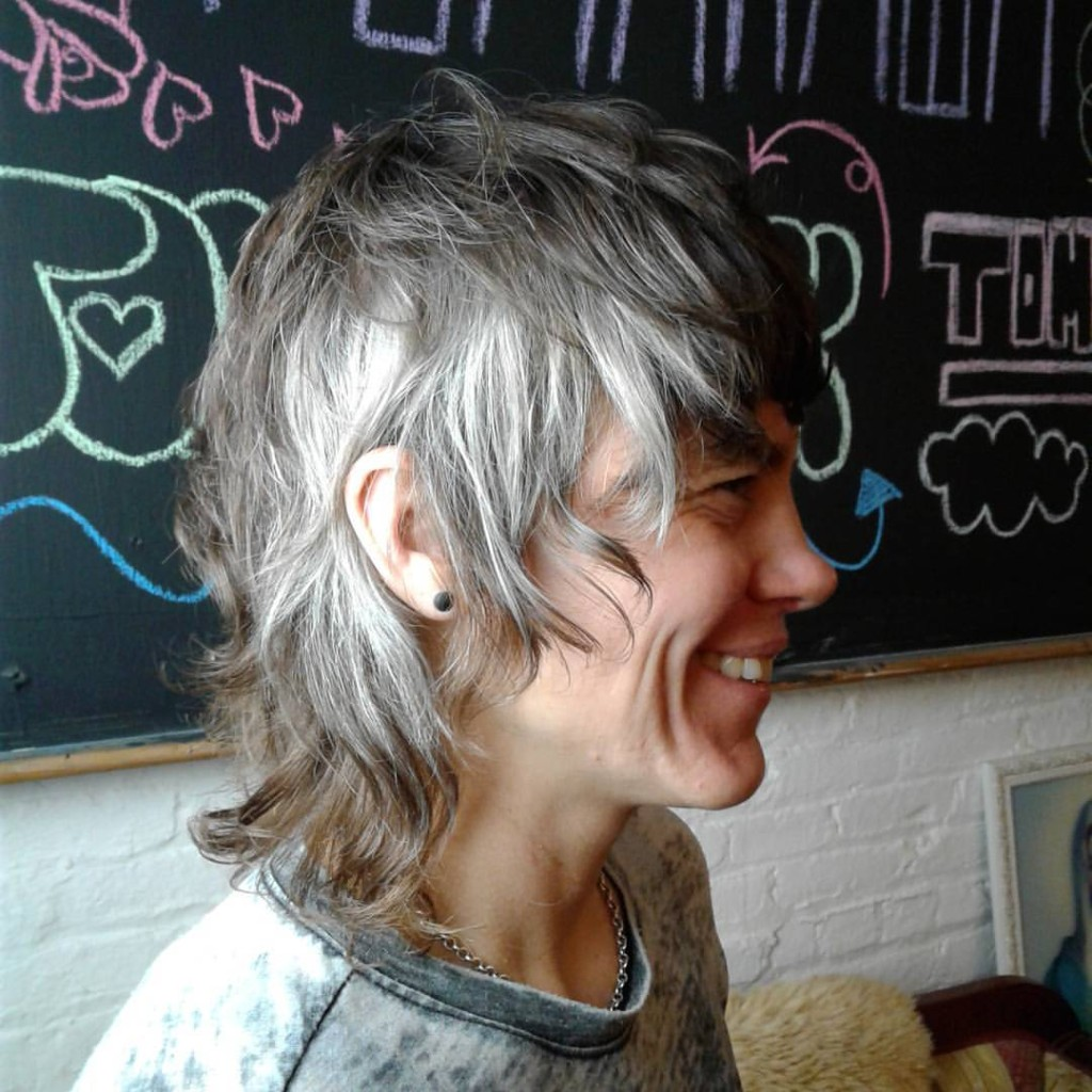 Donna Rae gave this client a rockin' shag and placed several steely silver panels around the sides and bang.