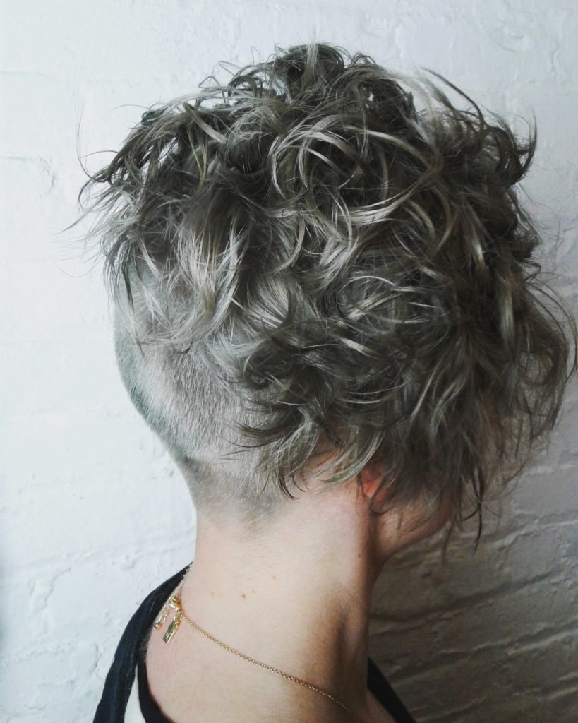 double process silver hair. short hair. curly hair.